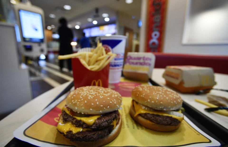 A McDonald's Quarter Pounder (right) and a Double Quarter Pound burger were shown with the new fresh beef on Tuesday.