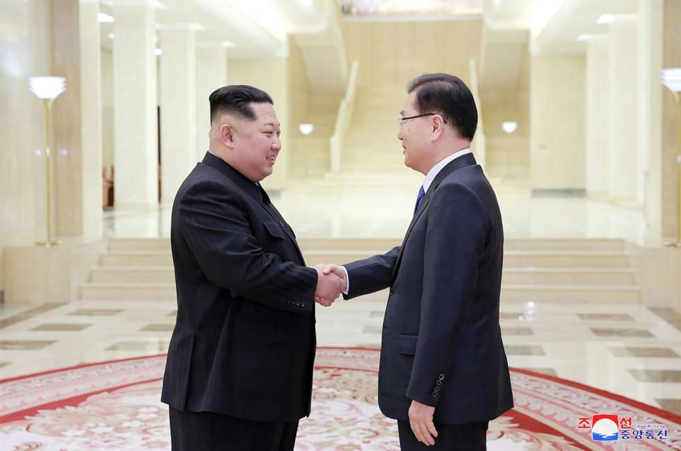 Korea's official Korean Central News Agency shows North Korean leader Kim Jong Un shaking hands with South Korean chief delegator Chung Eui-yong who travelled as envoys of the South's President Moon Jae-in during the
