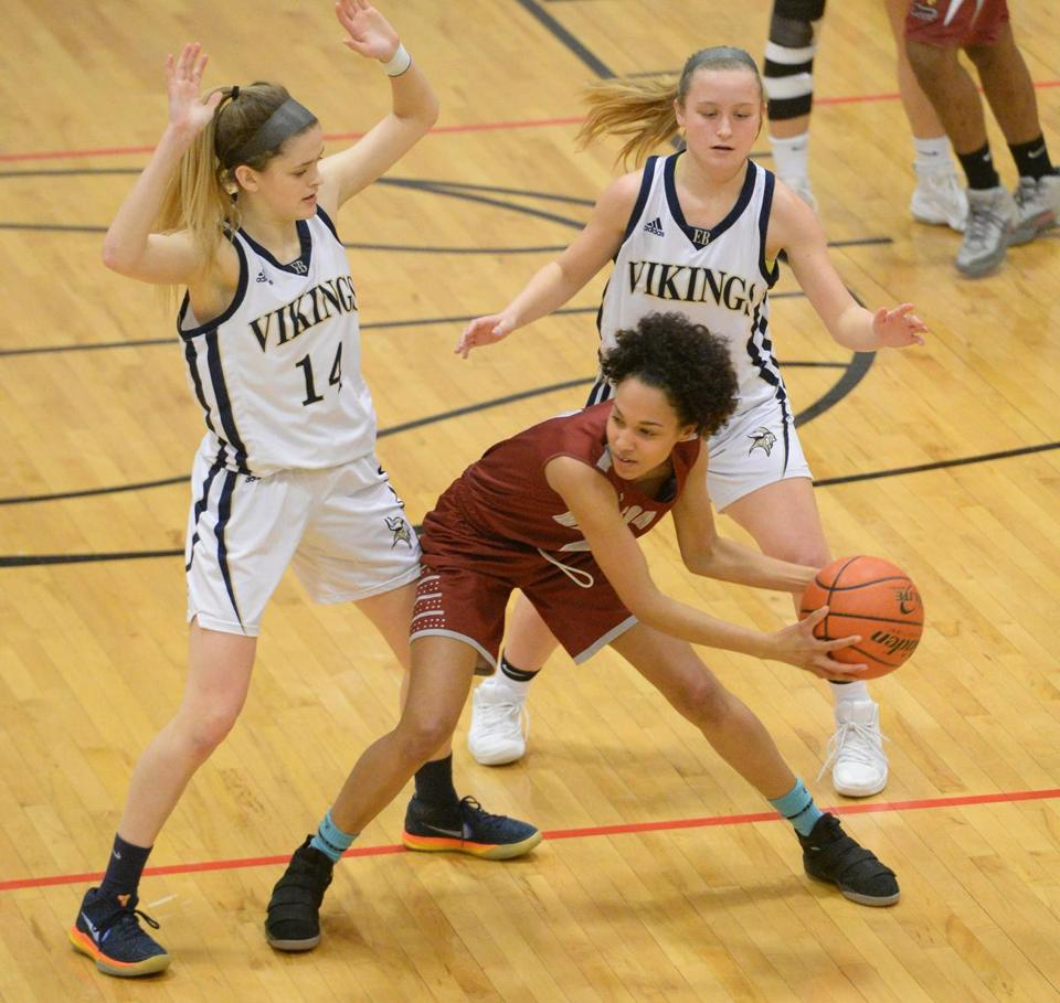From left, East Bridgewater's Peri Snow, and Kate Smith defend Madison Park's Francisca Barros-DePina, during their first round game division 3 game, Wednesday, Feb. 28, 2018. (Marc Vasconcellos/The Enterprise)