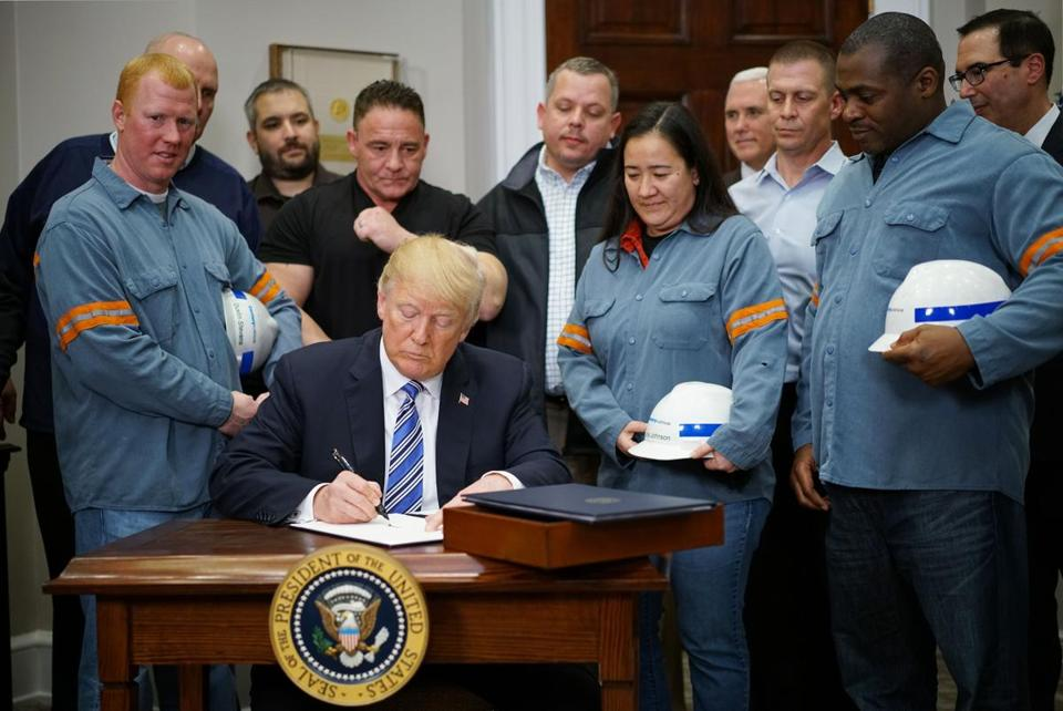 Trump signs sweeping tariffs, defying trade war warnings