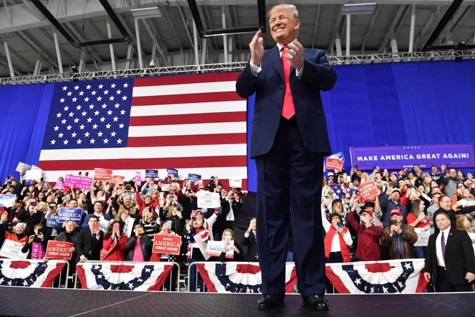 "TOPSHOT - US President Donald Trump applauds on stage at the Make America Great Again Rally on March 10, 2018 in Moon Township, Pennsylvania. President Trump travelled to Pennsylvania to speak at a "" Make America Great Again "" rally on behalf of Republican candidate Rick Saccone. / AFP PHOTO / Nicholas KammNICHOLAS KAMM/AFP/Getty Images"