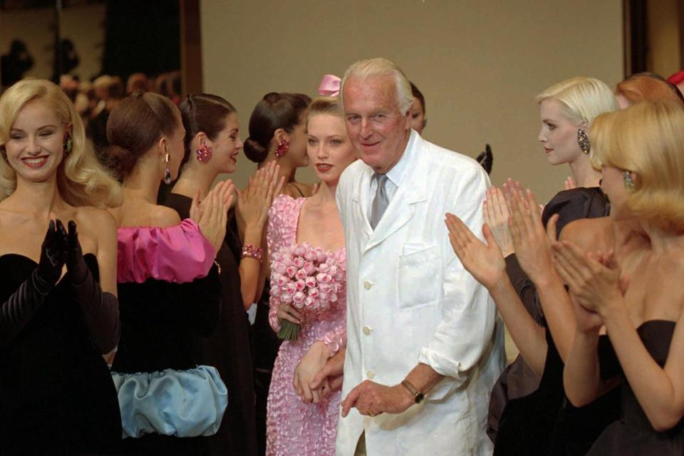 Mr. Givenchy with his models after an haute couture fashion show in Paris in 1995.
