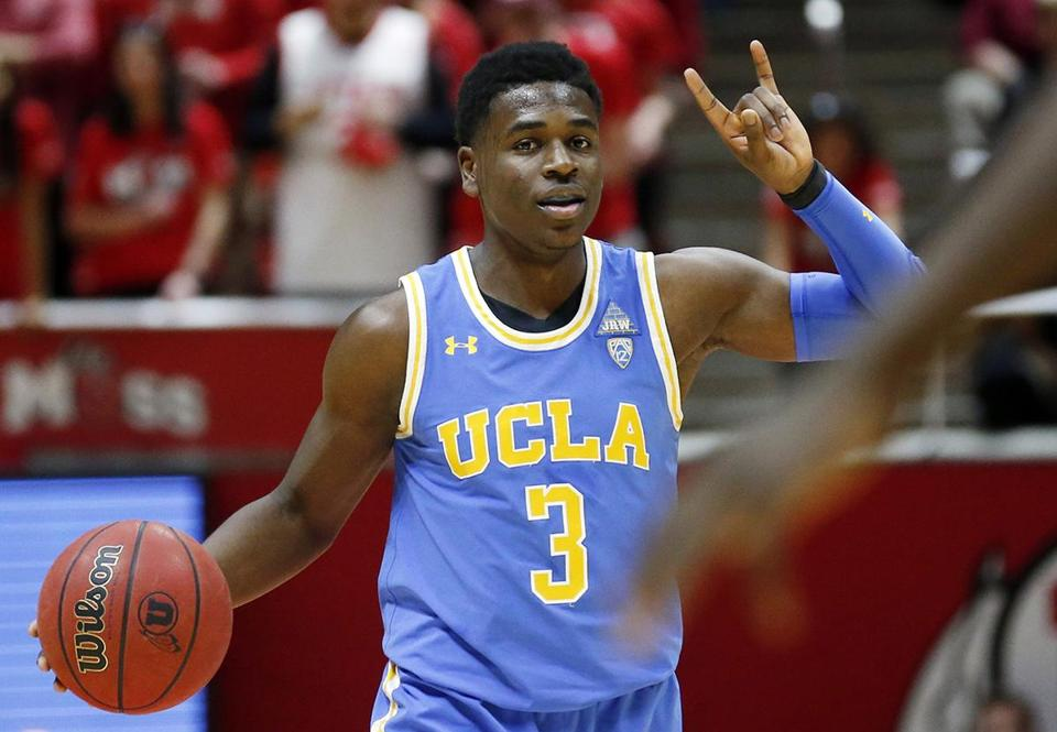 FILE - In this Feb. 22, 2018, file photo, UCLA guard Aaron Holiday (3) brings the ball up court during the first half during an NCAA college basketball game against Utah in Salt Lake City. Holiday was selected to the AP All-Pac-12 team on Tuesday, March 6, 2018. (AP Photo/Rick Bowmer, File)