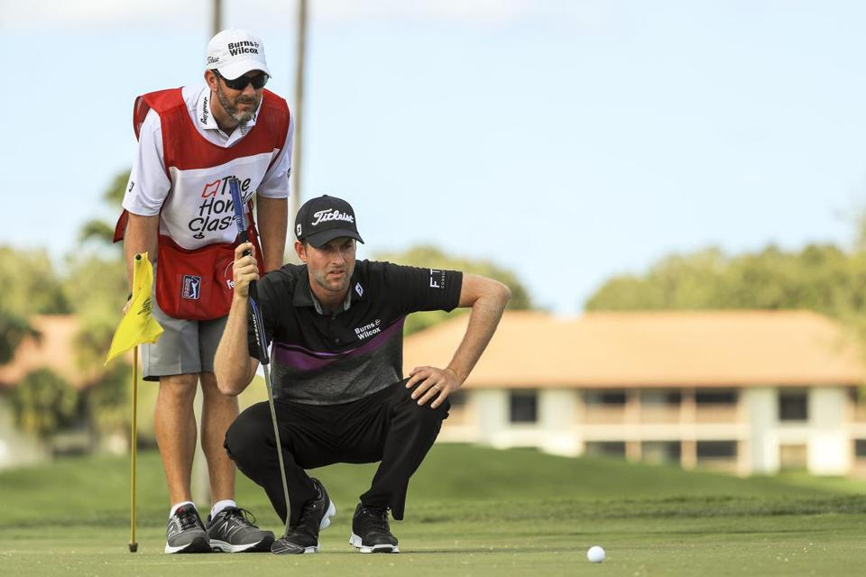 Webb Simpson and his caddie Paul Tesori lined up a putt on the third hole at the Honda Classic at PGA National Resort and Spa last month. Under new rules, caddies can no longer line up their players while they are setting up over a shot.