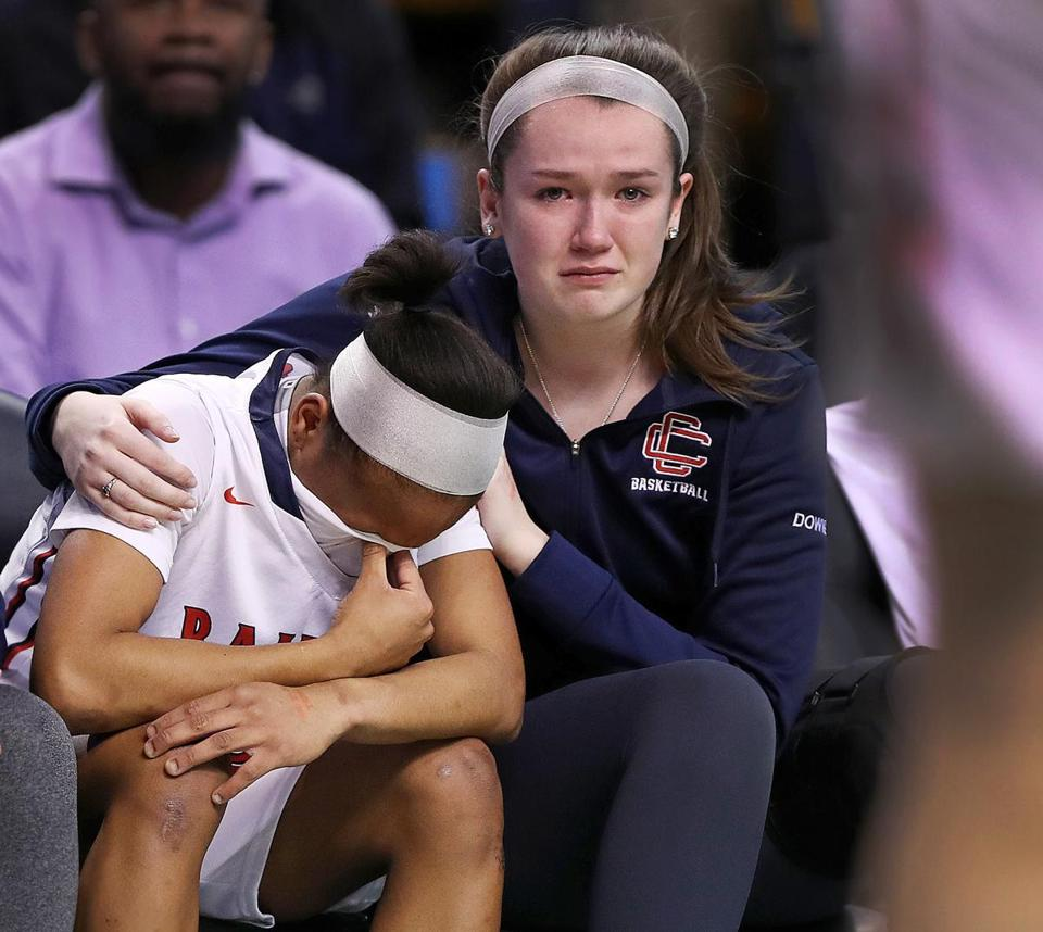 In the end, a tearful Emily Downer (right) could not console her emotional Central Catholic teammate, Nadeshka Bridewater, as they watched Braintree move on to the Div. 1 state championship.