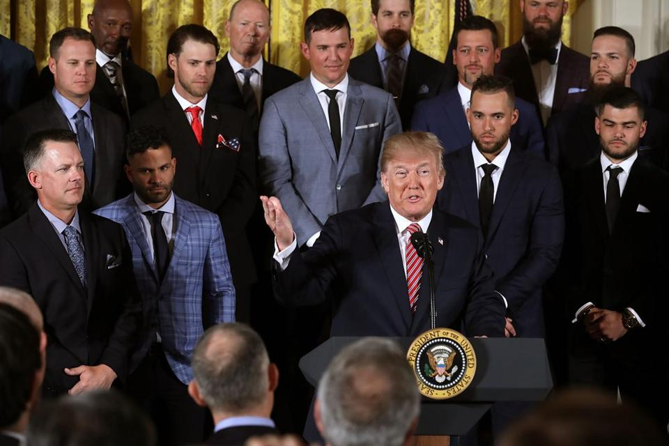 WASHINGTON, DC - MARCH 12: U.S. President Donald Trump (C) congratulates the Houston Astros while celebrating the team's World Series victory in the East Room of the White House March 12, 2018 in Washington, DC. Trump talked about Hurricane Harvey and the city and the team's resilience in the face of the storm. (Photo by Chip Somodevilla/Getty Images)