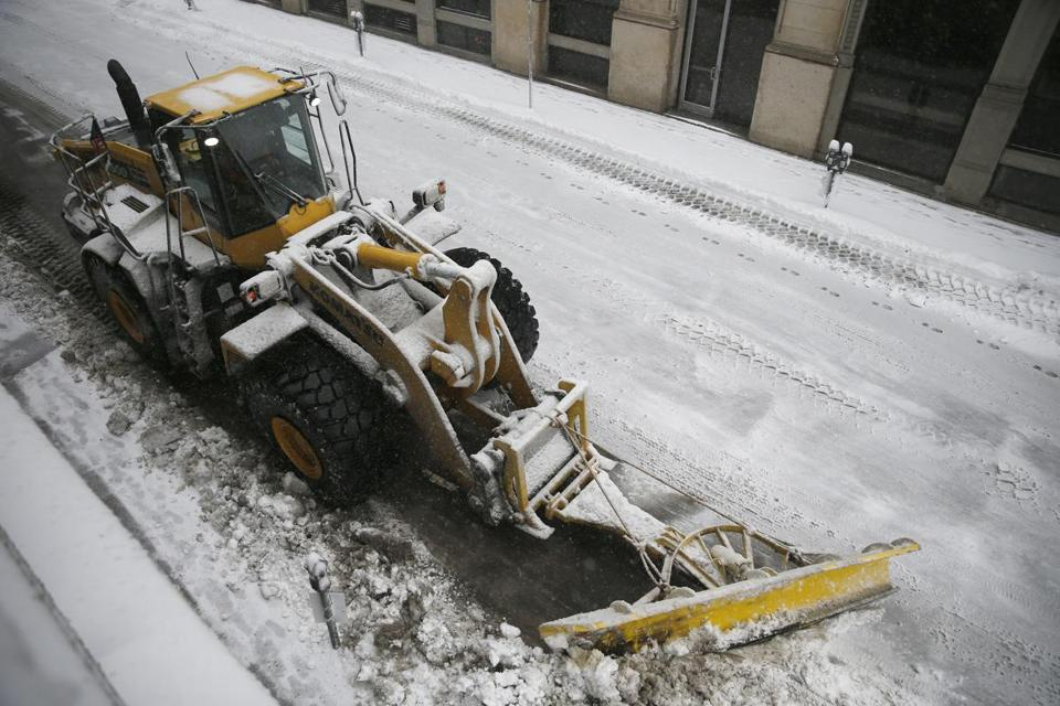 A plow worked to clear snow in Downtown Boston during the nor'easter Tuesday.