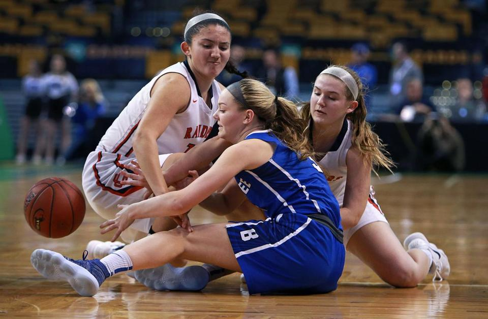 Braintree's Jenna Roche (center) battles Central Catholic's Adrianna Niles (left) and Maura Smith (right) for a loose ball in Monday night's Div. 1 girls' semifinal at TD Garden.