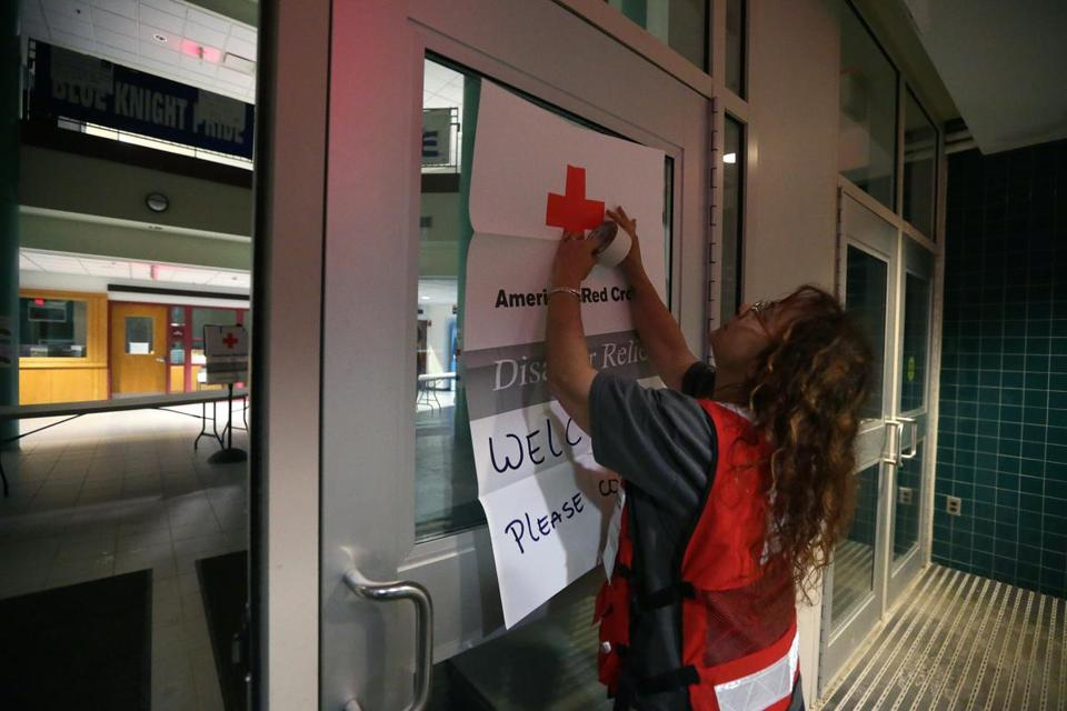 Shelter manager Jodi Wallace, of the American Red Cross, posted a welcome sign at Sandwich High School.