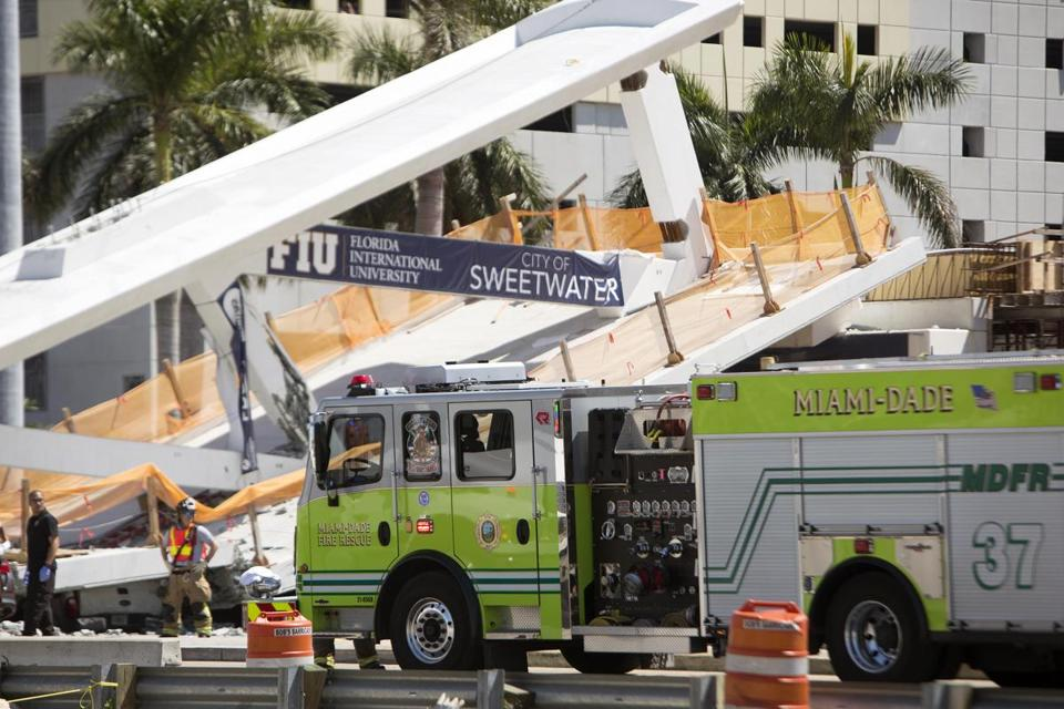 Pedestrian bridge collapses onto Miami road, crushing several cars
