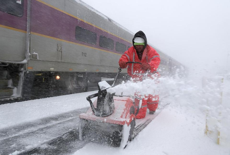 Lockport, MA: 03-6-2018: In blizzard conditions, Fred Silva cleared snow frosm the platform at the Rockport commuter rail station in Rockport, Mass. March 13, 2018. Photo/John Blanding, Boston Globe staff story/ ( )