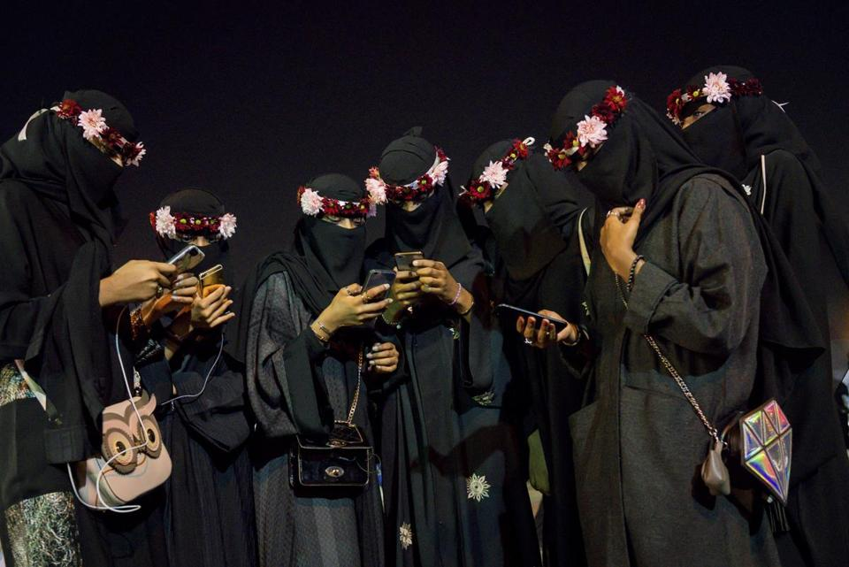 Women used their cellphones at Al-Jenadriyah, a cultural festival in Riyadh, last month.