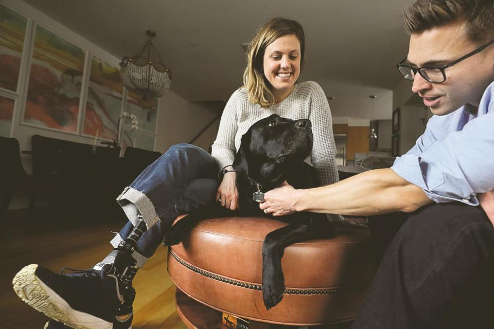 Jessica Kensky and Patrick Downes with Kensky's service dog, Rescue.