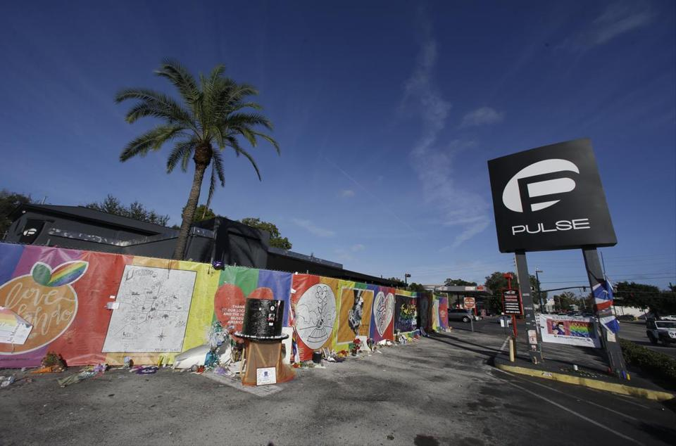 Orlando nightclub shooter's father was Federal Bureau of Investigation informant - widow's defense