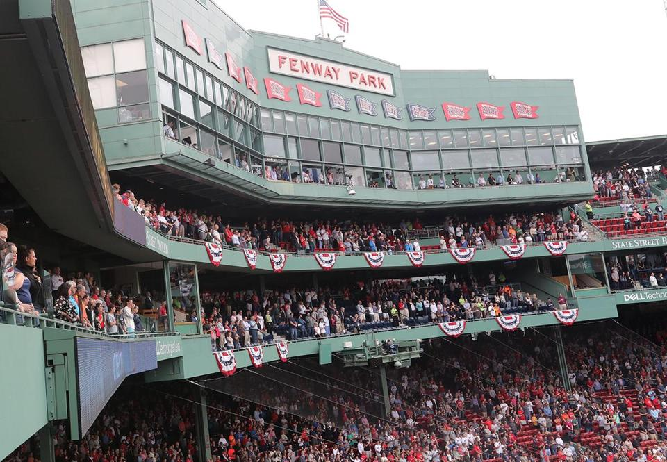 BOSTON, MA 10/08/2017 Fans stood for the singing of the National Anthem. The Boston Red Sox host the Houston Astros in Game Three of the ALDS at Fenway Park in Boston on Oct. 8, 2017. (Stan Grossfeld/Globe Staff)