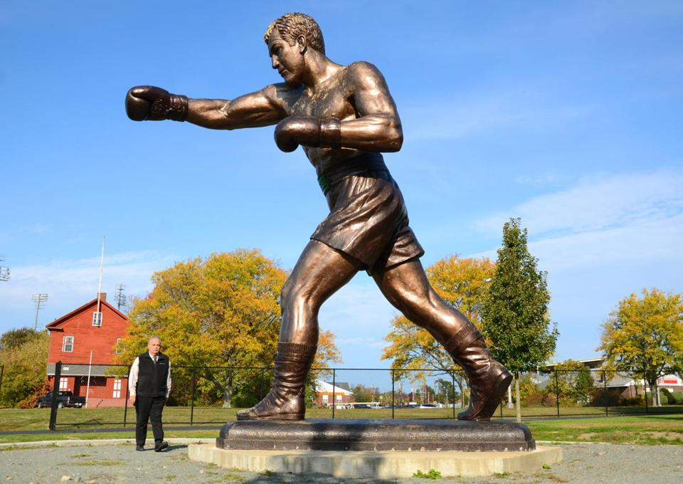 Rocky Marciano (above) is memorialized in Brockton with a statue near the entrance of the city's high school.