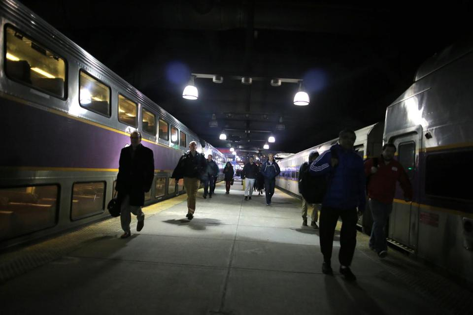 Passengers walked to their commuter trains on the platform at South Station earlier this month.
