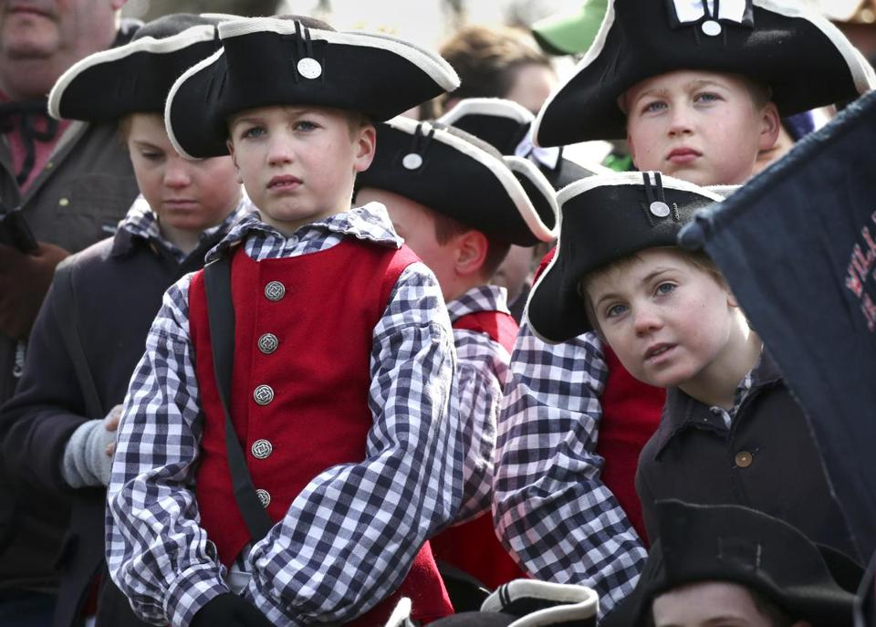 Members of the William Diamond Junior Fife & Drum Corp watched the ceremony in Bedford on Saturday.