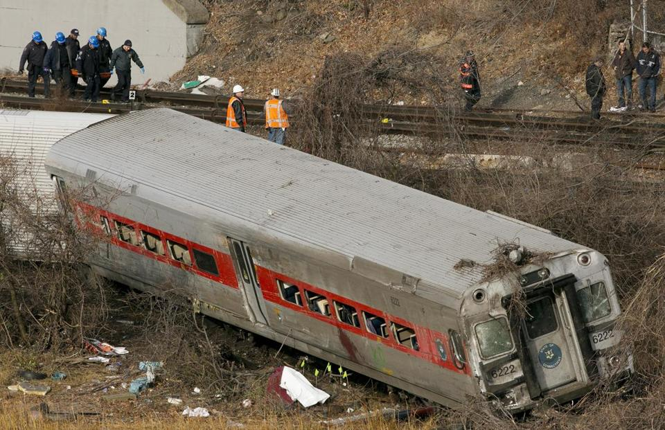 Personnel removed the body of a victim from the site of a train derailment in 2013 in New York City.