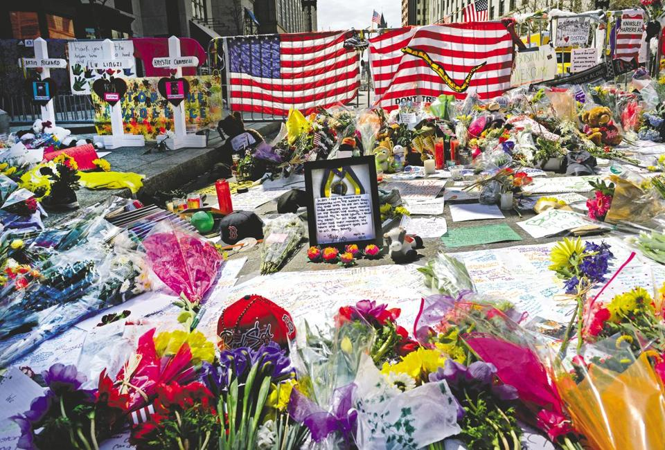 Flowers, medals, stuffed animals, written cards, and more were left at the Marathon finish line in the weeks after the attack. They have been boxed up and sit in storage.