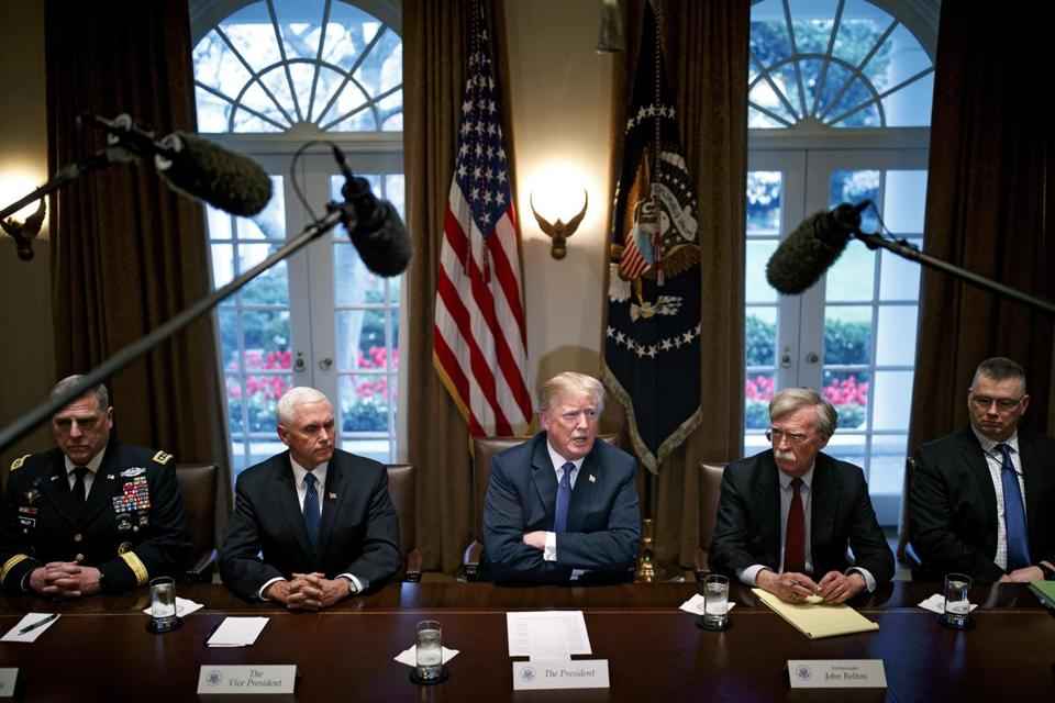 President Donald Trump (center) met with Vice President Mike Pence (left) and senior military leaders at the White House in Washington, D.C., Monday.