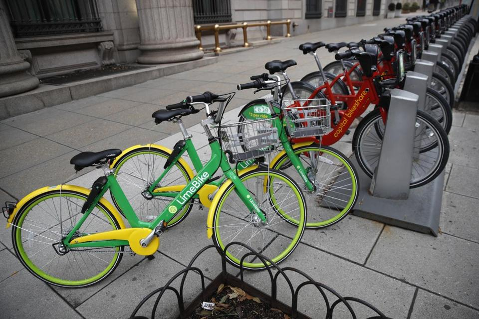 Two dockless LimeBike bicycles shared the sidewalk with other docked bikes in Washington, D.C.