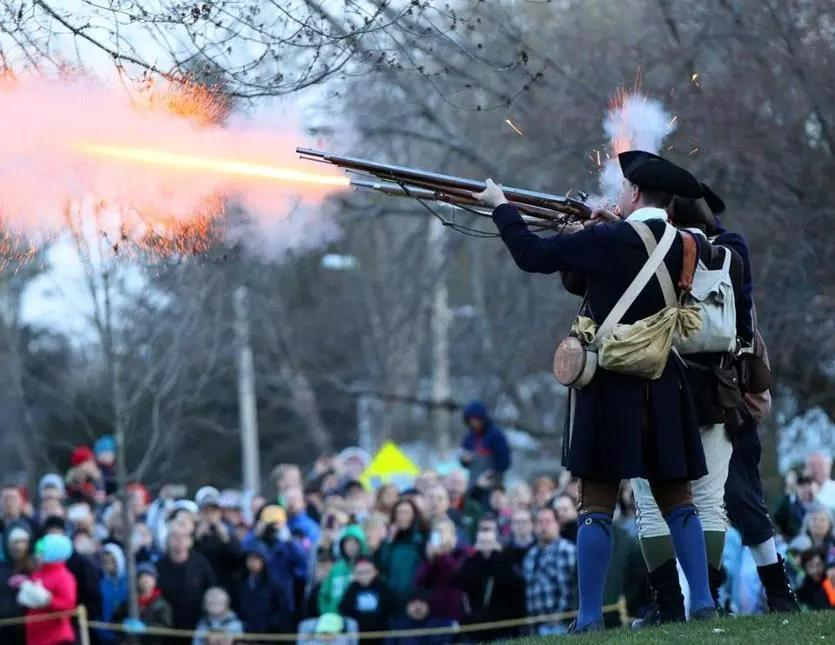 Minutemen fired their weapons in April 2016 as part of the reenactment of the 1775 Battle of Lexington.