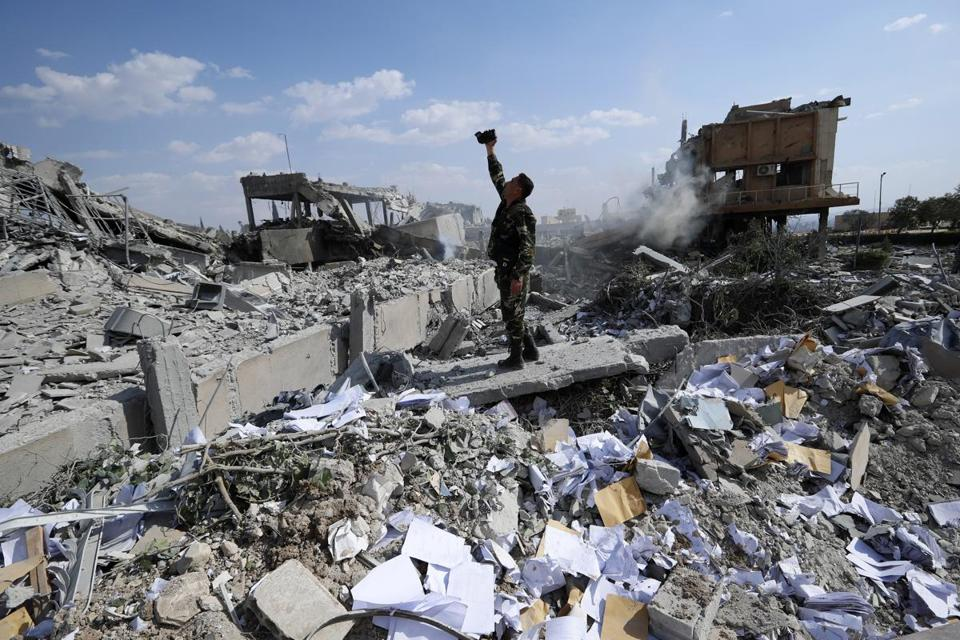 A Syrian soldier filmed the damage at the Barzah Research and Development Center near Damascus after the airstrikes.