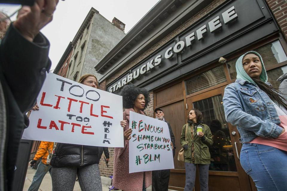 Protesters outside of a Starbucks in Philadelphia on Sunday, where two black men were arrested after employees called police to say the men were trespassing.