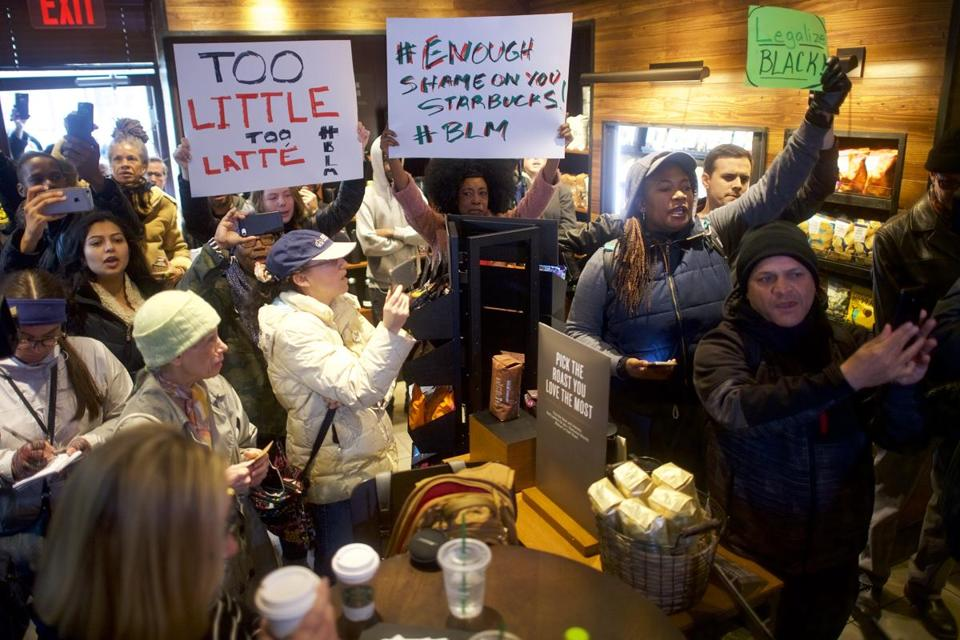Protesters on Sunday targeted the Starbucks in Philadelphia where two black men were taken into custody by police. Starbucks said the basis for the call to police was wrong.