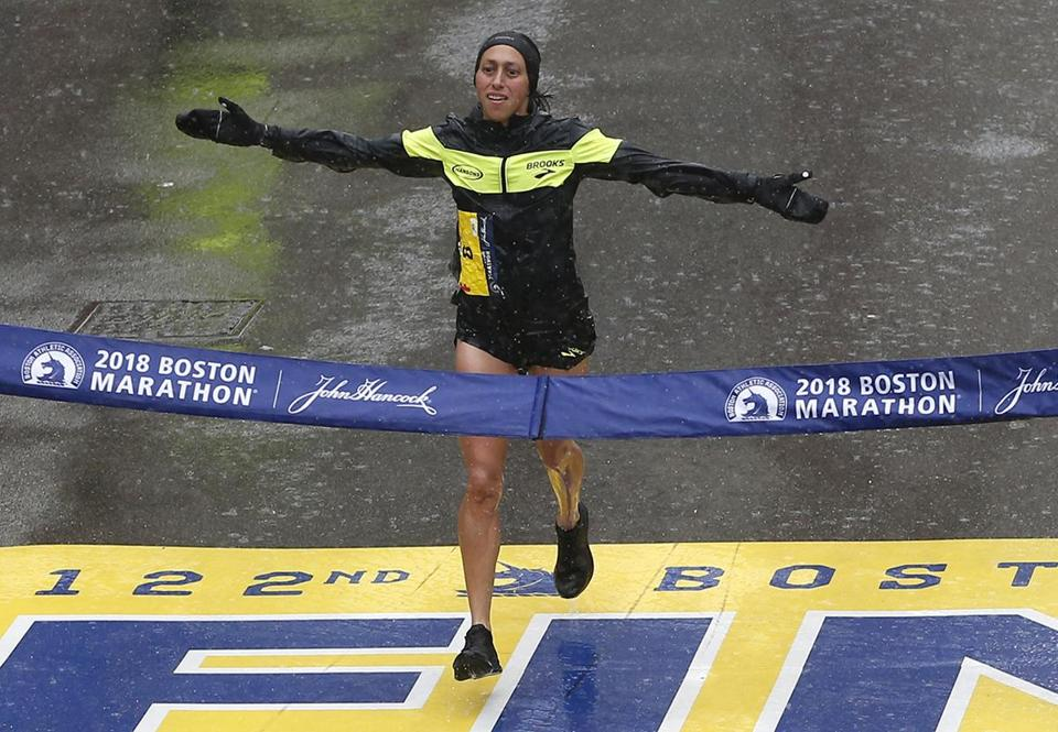 Desiree Linden hits the tape.