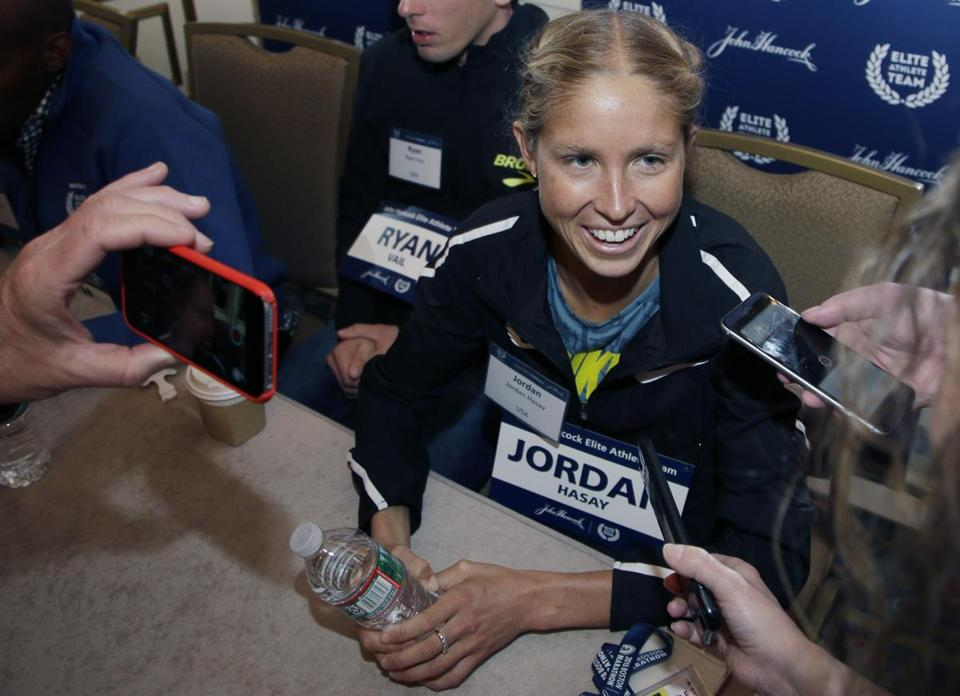 Elite U.S. runner Jordan Hasay speaks to reporters, Friday, April 13, 2018, in Boston. The 122nd running of the Boston Marathon is scheduled for Monday. (AP Photo/Elise Amendola)