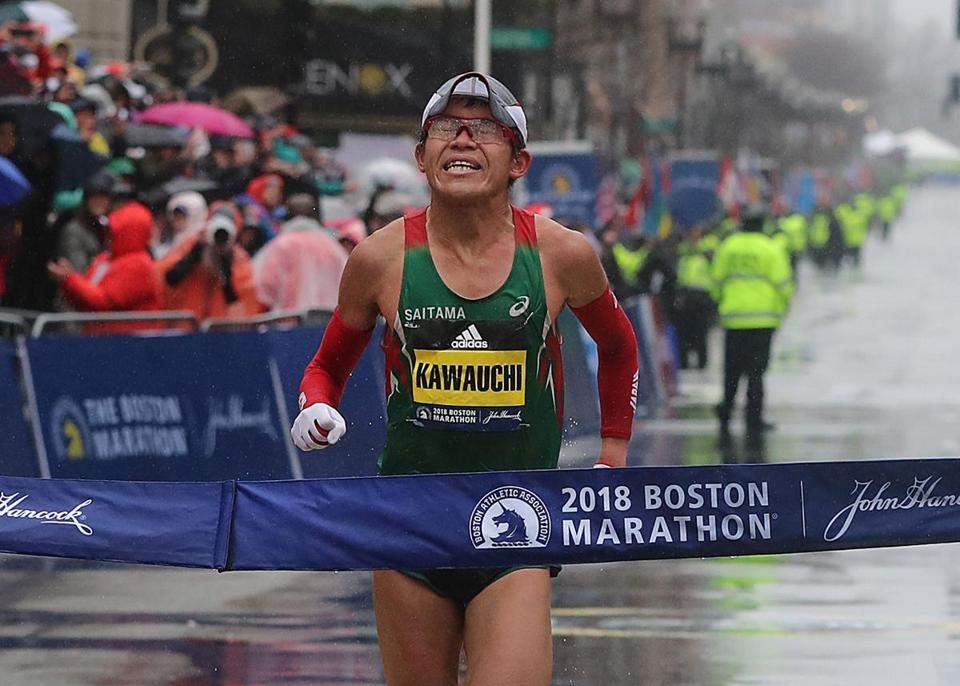 Kawauchi breaks the tape in Copley Square.