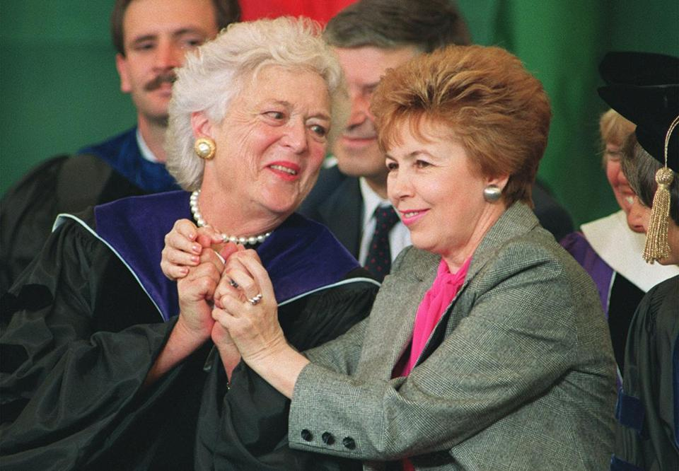 Raisa Gorbachev (right), wife of then-Soviet President Mikhail Gorbachev, raised the hands of first lady Barbara Bush.