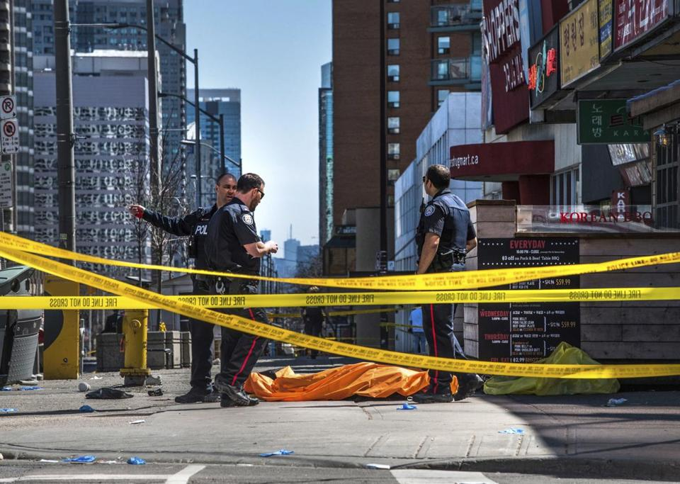 The sidewalk was strewn with bodies and injured pedestrians after the van jumped the curb and traveled about a mile, a witness said.