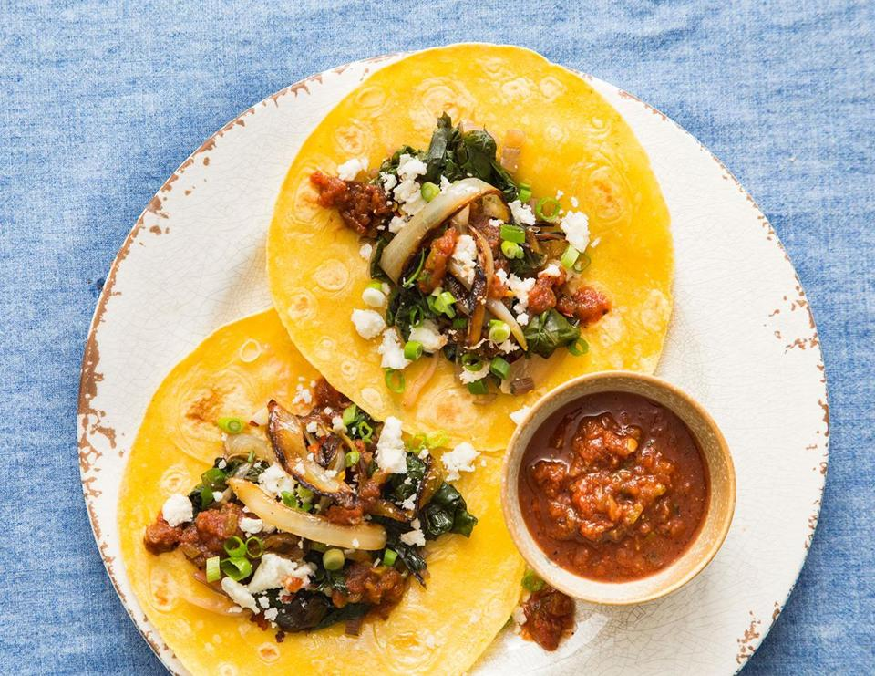 Mexican-style swiss chard, charred onion, and cheese tacos.