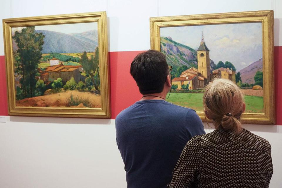 "Visitors looked at the painting ""Le clocher de Ria"" (""The bell tower of Ria"") at the museum dedicated to French painter Etienne Terrus."