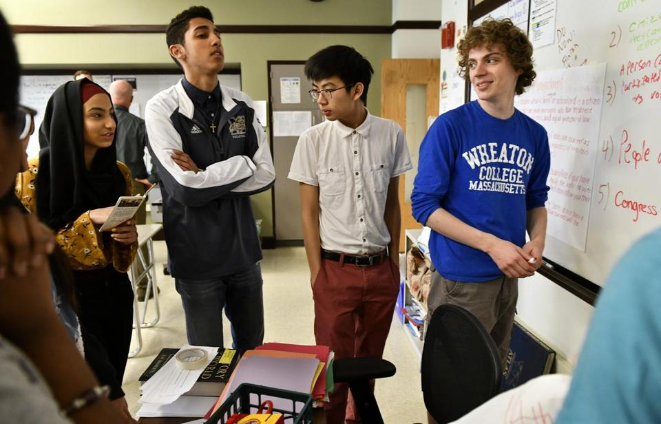 From left: Hajar El khalfouni, Marcelo Junior, Brendon Ky, and Harrison Zeiberg worked on an exercise in an AP Government class at Malden High school.