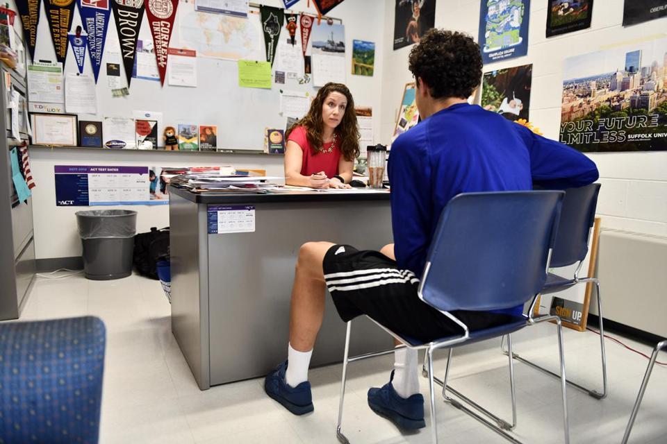Malden High School student Yassin Elhamin spoke with Erin Craven, a guidance counselor, as he discussed ways to make up course credits he missed while he lived in Morocco for a year.