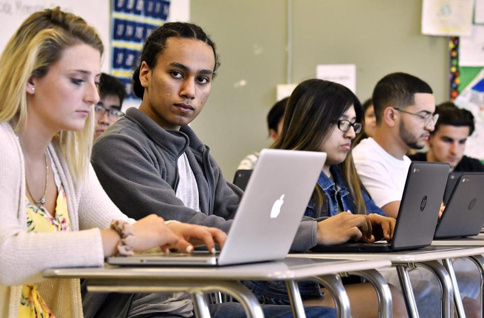 Amir Zaim, second from left, took notes during a review session in an AP Psychology class at Malden High School.