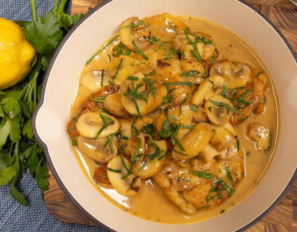 Monkfish tail medallions are seared in a pan and served with mushrooms in Marsala wine sauce.