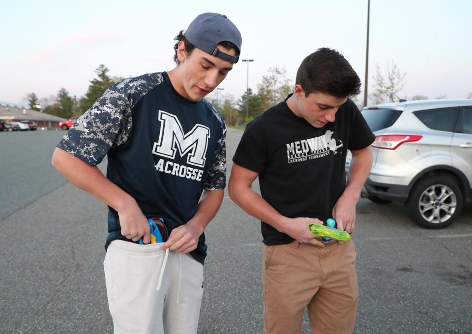Rob DiGregorio (right) and Joey Bevilacqua, both seniors at Medway High School, concealed their water weapons.