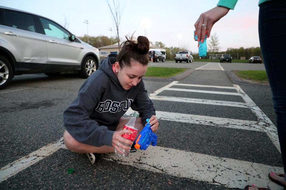 Meaghan Downing, a Medway senior, filled her water gun.