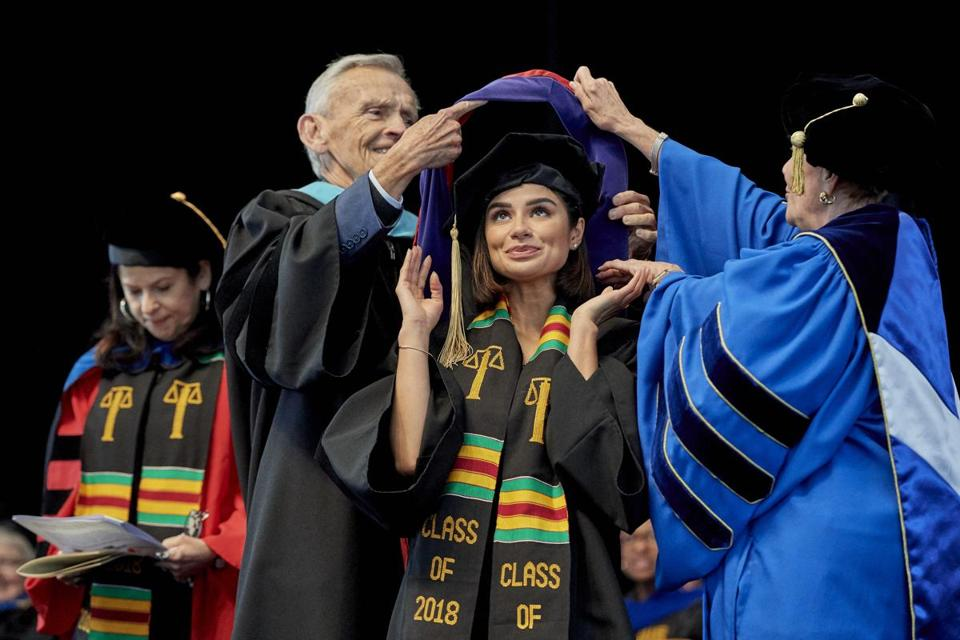 Diane Guerrero receives an honorary degree at Regis College.