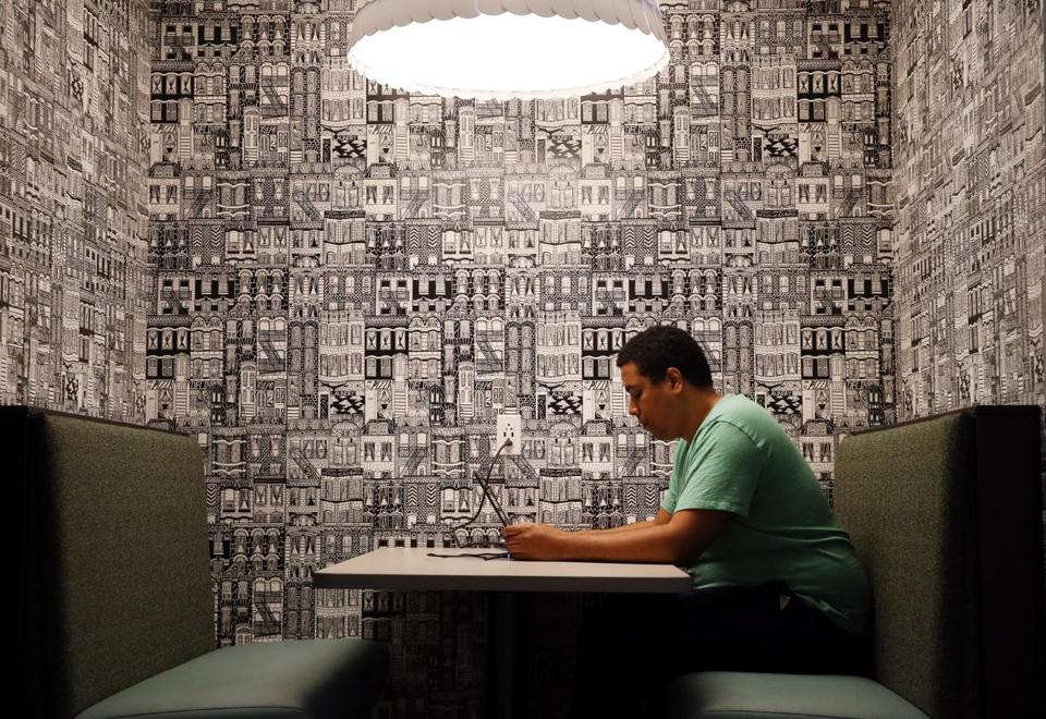 Thomas Berroa works in a coffee shop at Amazon's new Fort Point office, on Melcher Street in Boston.