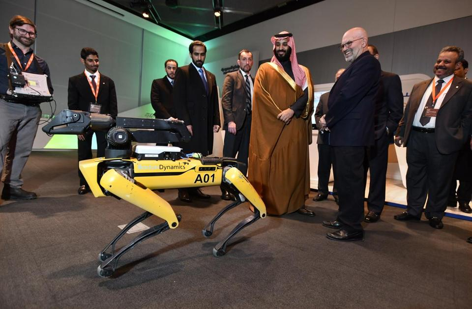 Crown Prince Mohammed bin Salman of Saudi Arabia toured MIT, including meeting Boston Dynamics' SpotMini, in March.