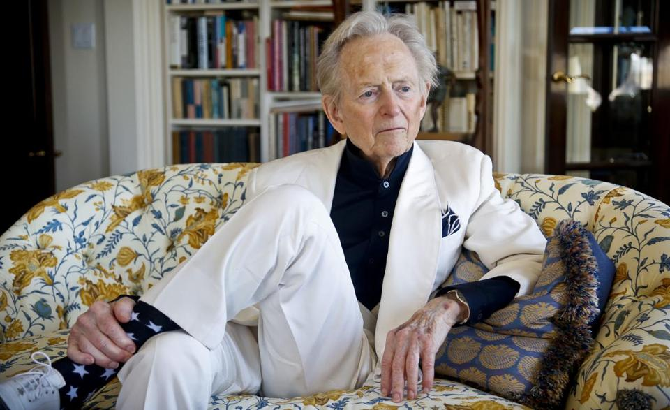 "FILE - In this July 26, 2016 file photo, American author and journalist Tom Wolfe, Jr. appears in his living room during an interview about his latest book, ""The Kingdom of Speech,"" in New York. Wolfe died at a New York City hospital. He was 87. Additional details were not immediately available. (AP Photo/Bebeto Matthews, File)"