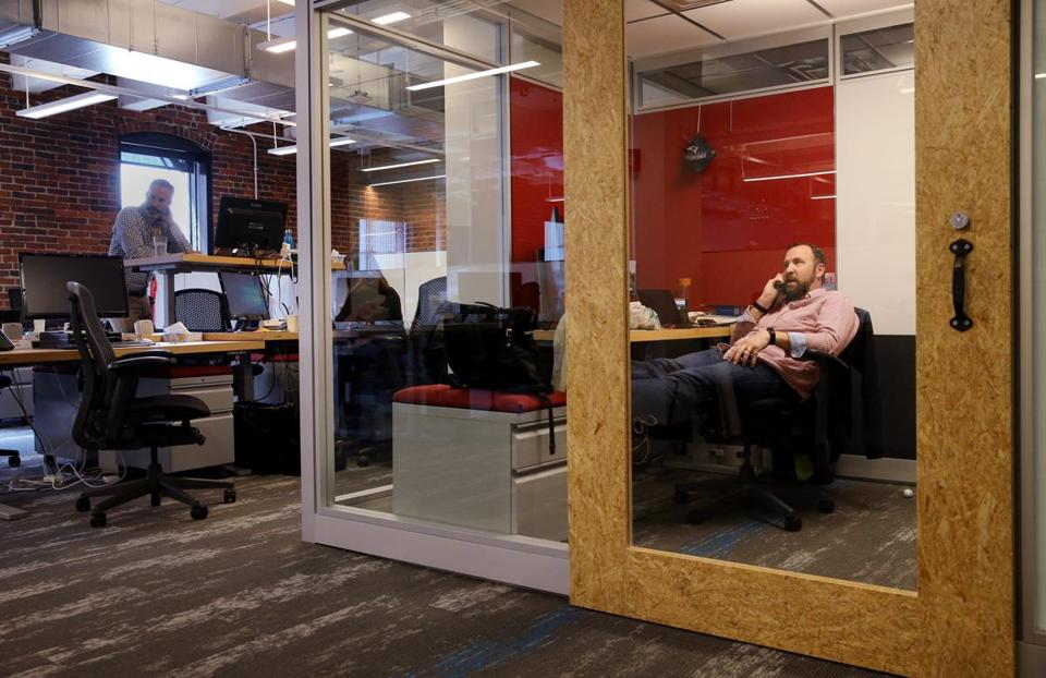 Chris Goodman took a call in his office at Amazon's new Fort Point office in Boston.