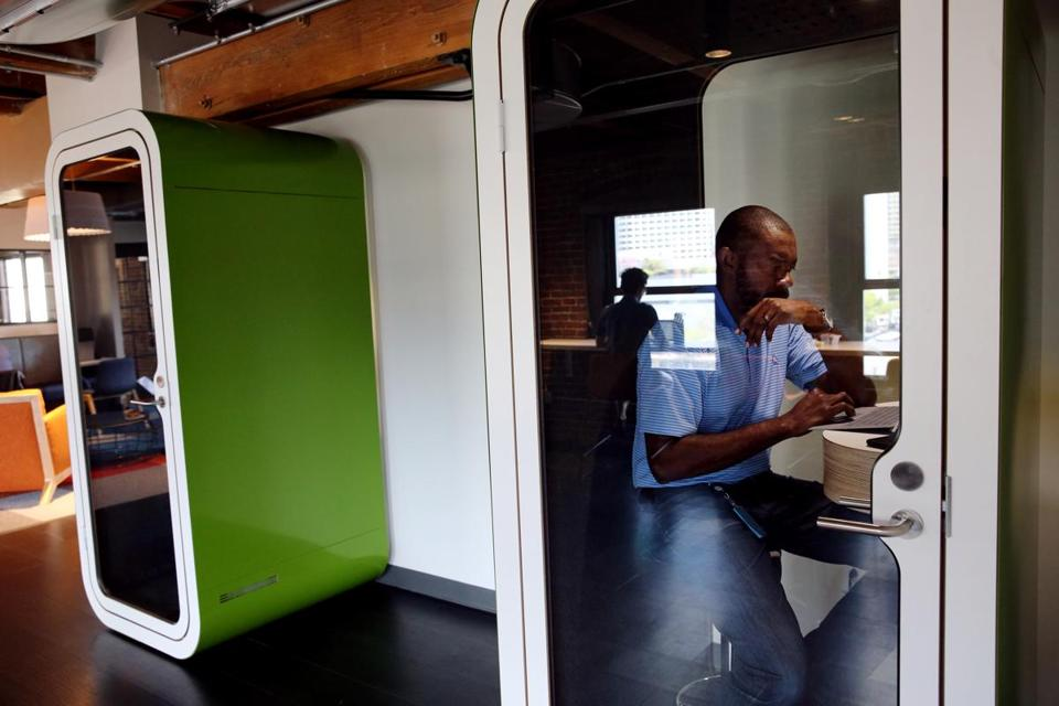 Thaddeus Jones worked in a phone booth at Amazon's new Fort Point office.