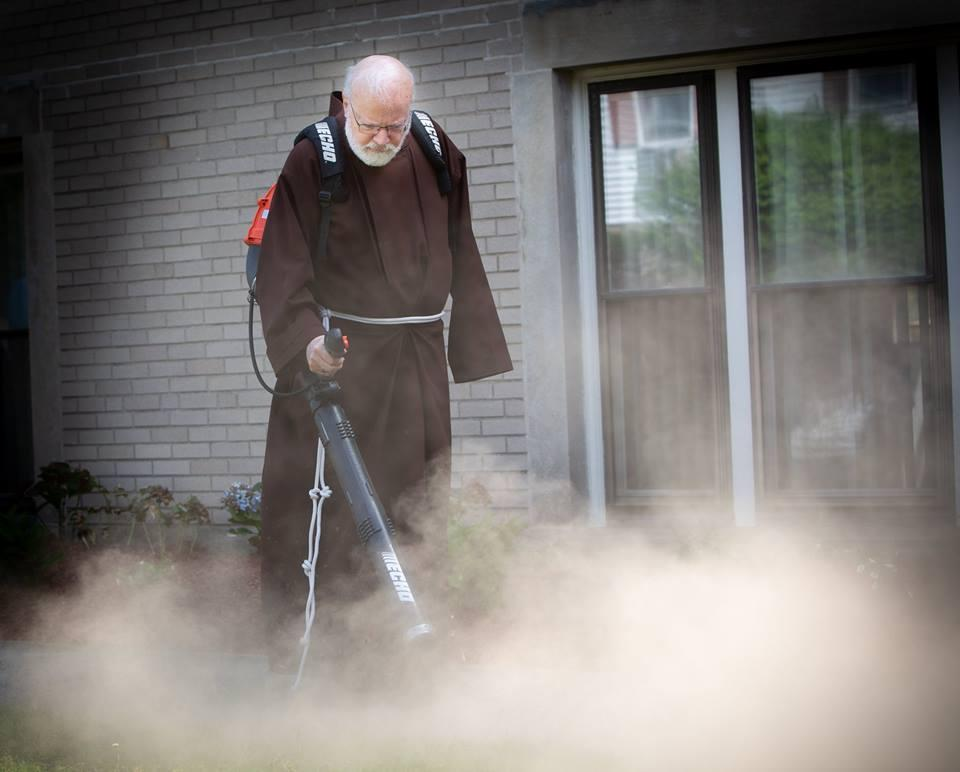 Cardinal Seán O'Malley helped out with the archdiocese's annual service week by blowing leaves away from a Quincy church.